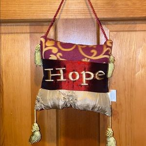 Hope pillow accent   Maroon green and gold.